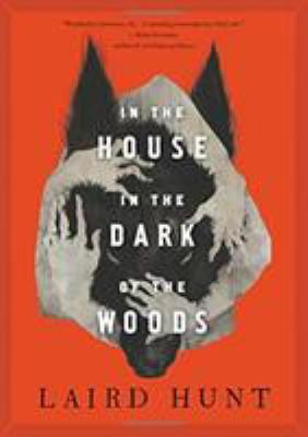 Cover image for In the house in the dark of the woods