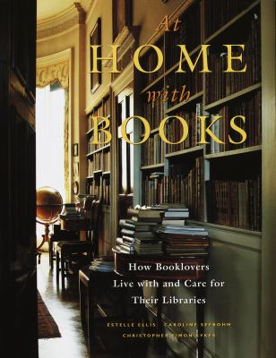 Cover image for At home with books : how booklovers live with and care for their libraries