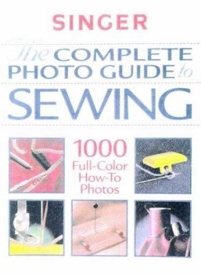 Cover image for Singer : the complete photo guide to sewing.