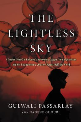 Cover image for The lightless sky : a twelve-year-old refugee's harrowing escape from Afghanistan and his extraordinary journey across half the world