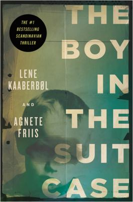 Cover image for The boy in the suitcase