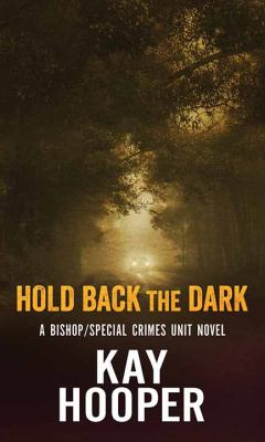 Cover image for Hold back the dark
