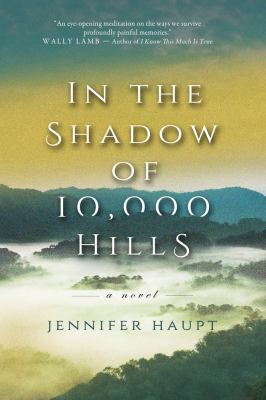 Cover image for In the shadow of 10,000 hills : a novel