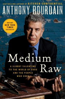 Book cover image: Anthony Bourdain in a suit and tie, looking intensely at camera with a knife in his hands