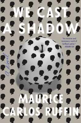 Book cover image of We Cast a Shadow: a white surface dotted with black cameo-style proflies, and an appe on it, seen from above (the apple is also white and dotted with black cameo-style profiles).