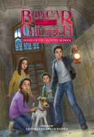 Cover image for Hidden in the haunted school