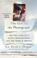 Cover image for The girl in the photograph : the true story of a Native American child, lost and found in America