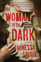 Cover image for The woman in the dark