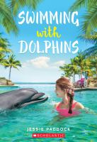 Cover image for Swimming with dolphins
