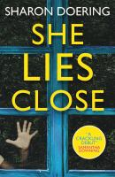 Cover image for She lies close