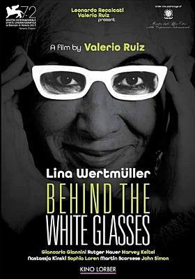 Behind white glasses